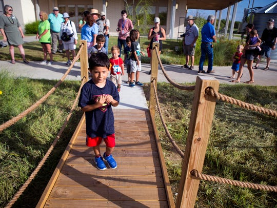 Camden Gonzalez, 4, is the first to enter the newly