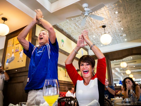 Francesca Fortin, right, and Alain Rabault cheer after