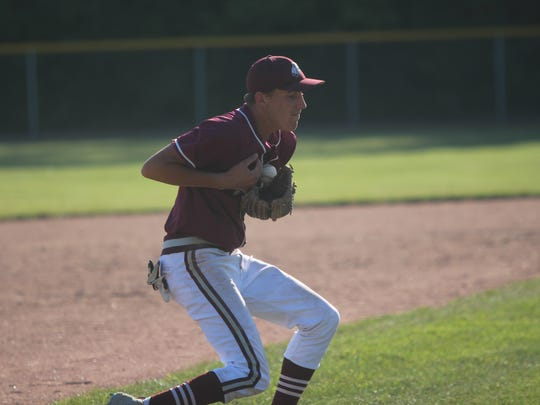Menomonee Falls third baseman Henry Hansen finds the handle on a ground ball in a sectional final against Germantown on July 16, 2018.