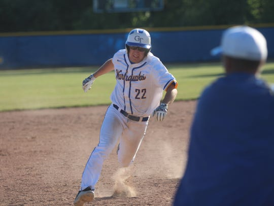 Germantown pinch runner Jayden Schaefer is waved home