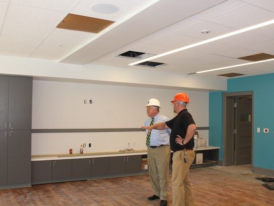 Pittsford Recreation Director Jessie Hollenbeck shows Pittsford Town Supervisor Bill Smith around the renovated center.