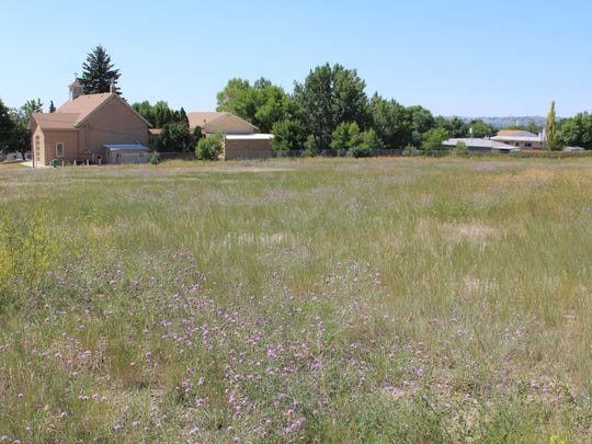 The empty lot north of the Blessed Sacrament Parish will one day be the site of a new fire hall for the community of Black Eagle