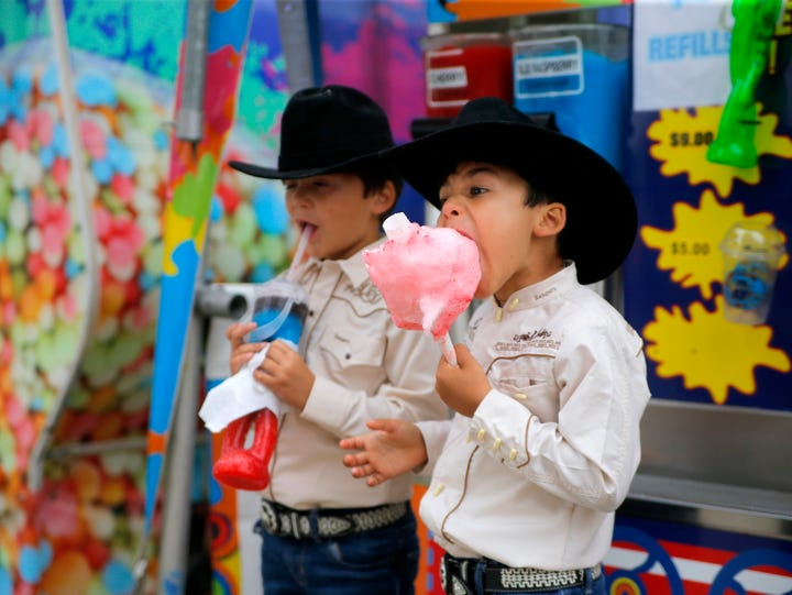 Two young cowboys enjoys some treats at the California