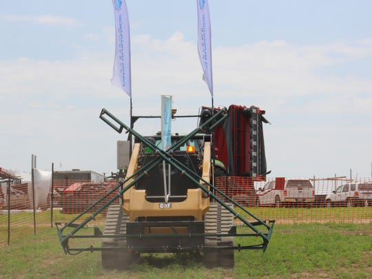 The world's first fully driverless farm equipment, offered as a custom farming service was introduced at Wisconsin Farm Technology Days in mid-July.