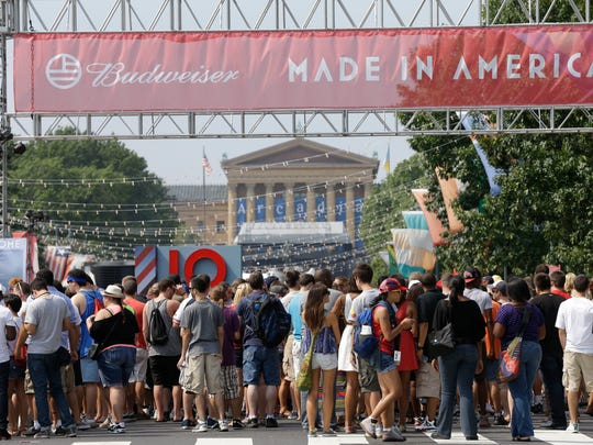 """People line up to enter the """"Made in America"""" music"""