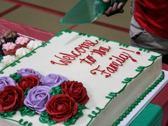 A cake welcomed Bly Coddington and his wife and two children to his birth parents' families.
