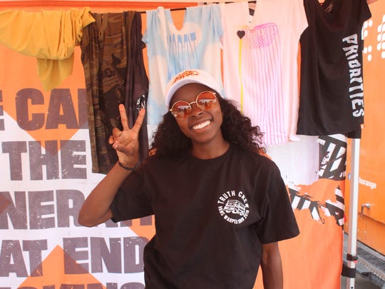 Kami Thomas has been working at the Truth tent for Vans Warped Tour for two years.