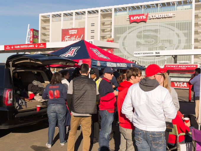 Arizona Wildcats fans tailgate before the Foster Farms