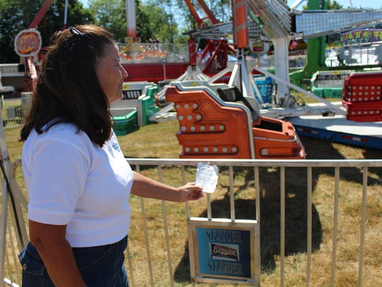 Eileen Franko looks over a rides safety tag.