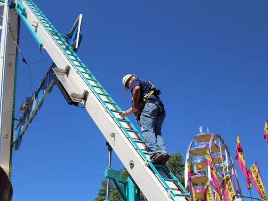 Brian Koch, a New York safety inspector, climbs an amusement ride as part of an inspection.