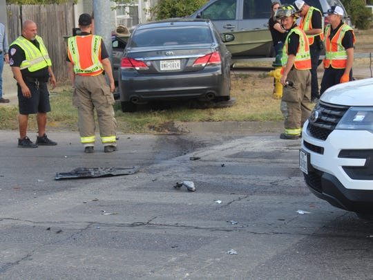 Officers working to help with the crash on Shiloh and