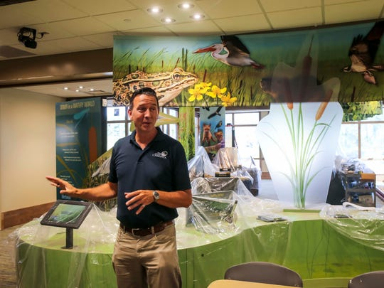 Polk County Conservation Director Richard Leopold shows the Jester Park Nature Center live animal and educational exhibits Friday, July 27, 2018, near Granger, Iowa