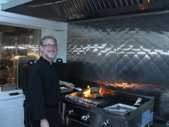 Chef Jeff Rose from CAYA Smokehouse Grill grilled lamb