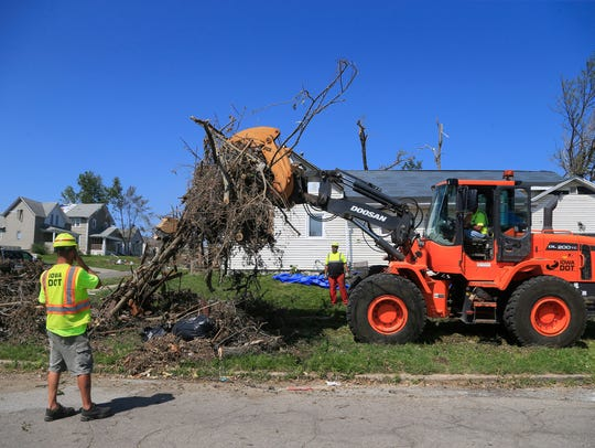 Crews clear debris in Marshalltown Tuesday, July 31, 2018. The city was rocked by an EF-3 tornado that struck on July 19.
