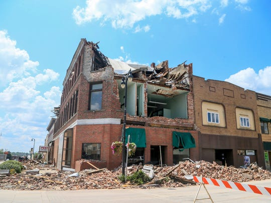 Debris lines the street in Marshalltown Tuesday, July 31, 2018. The city was rocked by an EF-3 tornado that struck on July 19.