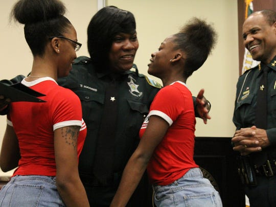 Newly sworn in Leon County Sheriff's Office correctional officer Tawana Harris embraces her daughters T'Kayla Dickey and Tykerria Bush on Friday.