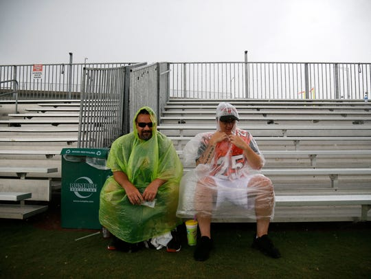 Bengals fans attempt to weather a sudden storm during