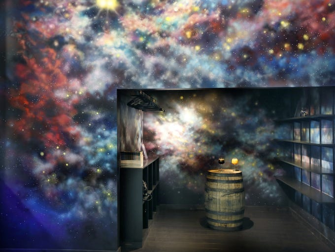 The galaxy mural by Aubrey Roemer at Mortalis Brewing