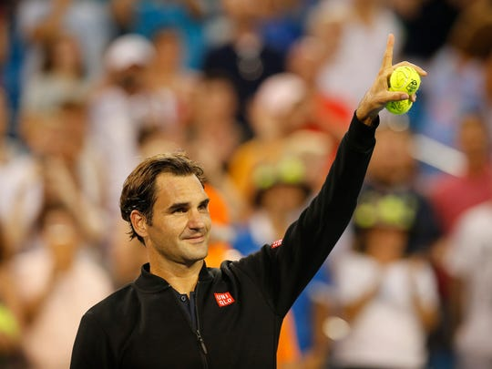 Roger Federer celebrates after winning the match between Federer and Peter Gojowczyk in the second round of the Western & Southern Open at the Lindner Family Tennis Center in Mason, Ohio, on Tuesday, Aug. 14, 2018. Federer won in straight sets.