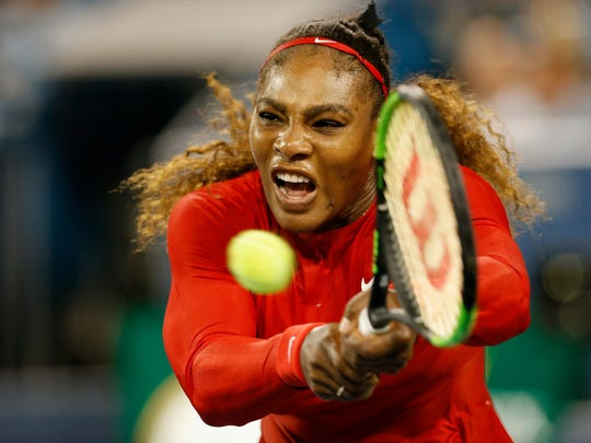 Serena Williams returns a shot in the second set of