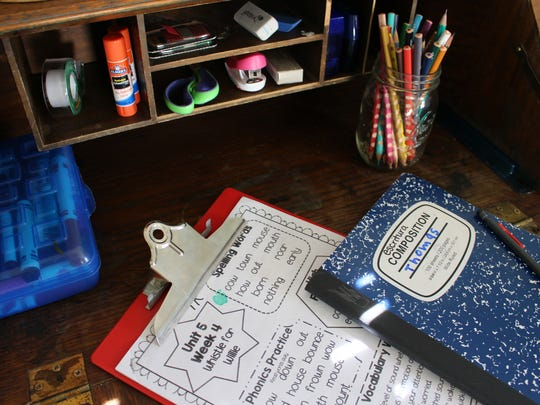 A clipboard can help keep pages of a homework packet together until it is complete.
