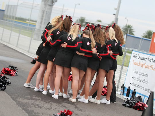 Prayer time for Jupiter Christian School varsity cheerleaders