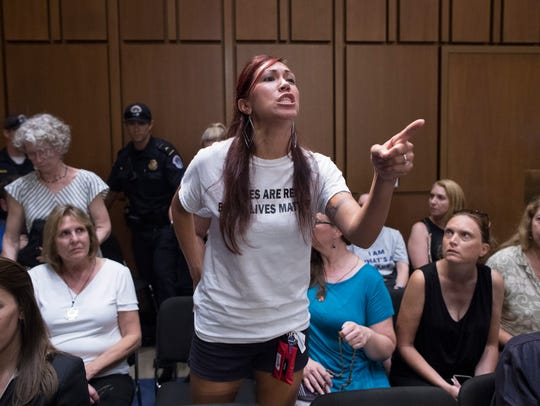 A women's reproductive rights activist protests Judge Brett Kavanaugh's nomination to the U.S. Supreme Court during the Senate Judiciary Committee's confirmation hearing in the Hart Senate Office Building in Washington, D.C., on Sept. 5, 2018.