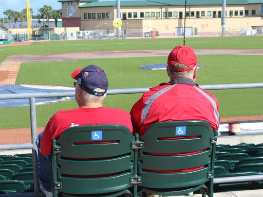 Two Cardinals fans take in the sights at Roger Dean Chevrolet Stadium.