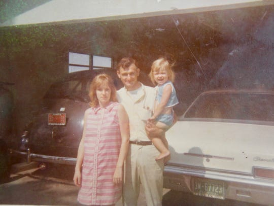 Brenda Coston as a child, with her parents, Lavern