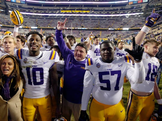 LSU coach Ed Orgeron sings the school alma mater with