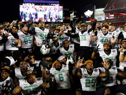 Marshall Thundering Herd players celebrate after beating South Florida in the Gasparilla Bowl.