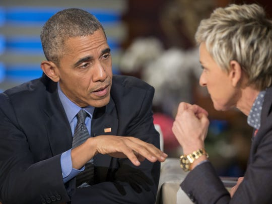 President Barack Obama talks with Ellen DeGeneres during
