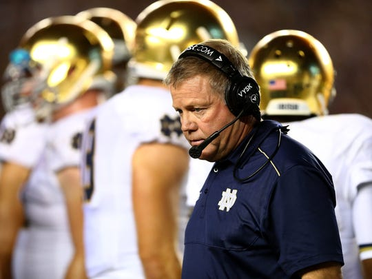Head coach Brian Kelly of Notre Dame walks the sidelines against the Florida State Seminoles at Doak Campbell Stadium on Oct. 18, 2014.