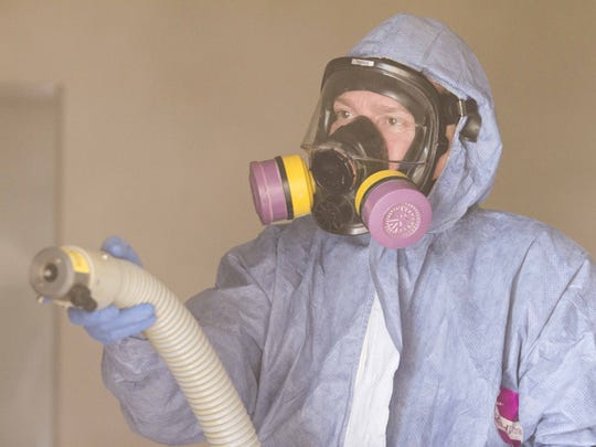 Jeffrey Lowman/The Republic  Dale Cillian uses chemicals to fog a Glendale residence believed to be contaminated with Methicillin-resistant Staphylococcus aureus, or MRSA, during a cleaning earlier this month. Dale Cillian, owner of Biohazard Cleanup Company uses chemicals to fog a Glendale residence believed to be contaminated with Methicillin-resistant Staphylococcus aureus, or MRSA, Wednesday, November 12th, 2014, in Glendale, Ariz. Cillian used a chemical that would also be used to clean areas contaminated with viruses such as Ebola.