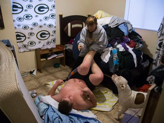 Austin Tautfest, 14, kicks his grandmother Emily Harrison, during an angry episode. Austin did not want to wake up and go to school. Austin's siblings at times are afraid of their brother because of his outbursts.