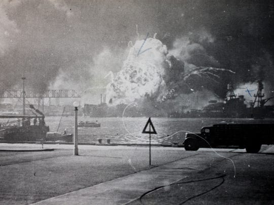A fireball erupts from the  USS Arizona after an armor piercing bomb explodes near the ammunition storage area.