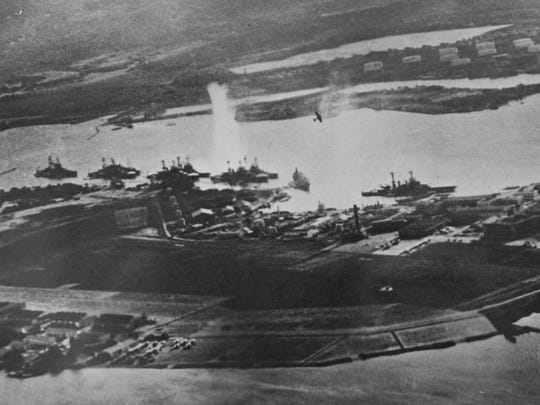 """A bomb explodes in the water near """"Battleship Row"""" during the attack on Pearl Harbor. This photo was taken by Japanese airmen."""