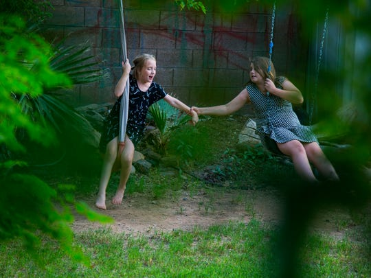 Miranda DeYoung, 12, on right, who suffers from Asperger Syndrome and attention deficit hyperactivity disorder plays with her sister Haley DeYoung, 9, at their home. Miranda can be rough with her sister sometime due to her mental health problems.