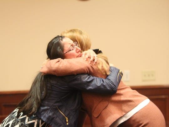 Vanessa Pender, the wife of Jacobi Pender hugs Stephanie