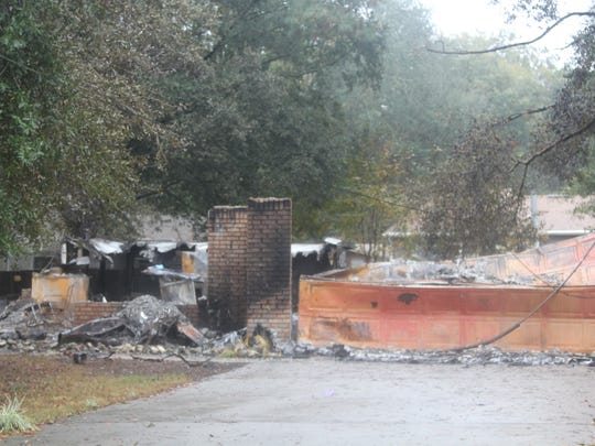 The fire-gutted home in the Plantation Woods neighborhood