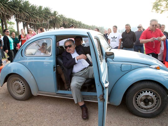 Uruguay President Jose Mujica arrives at a polling