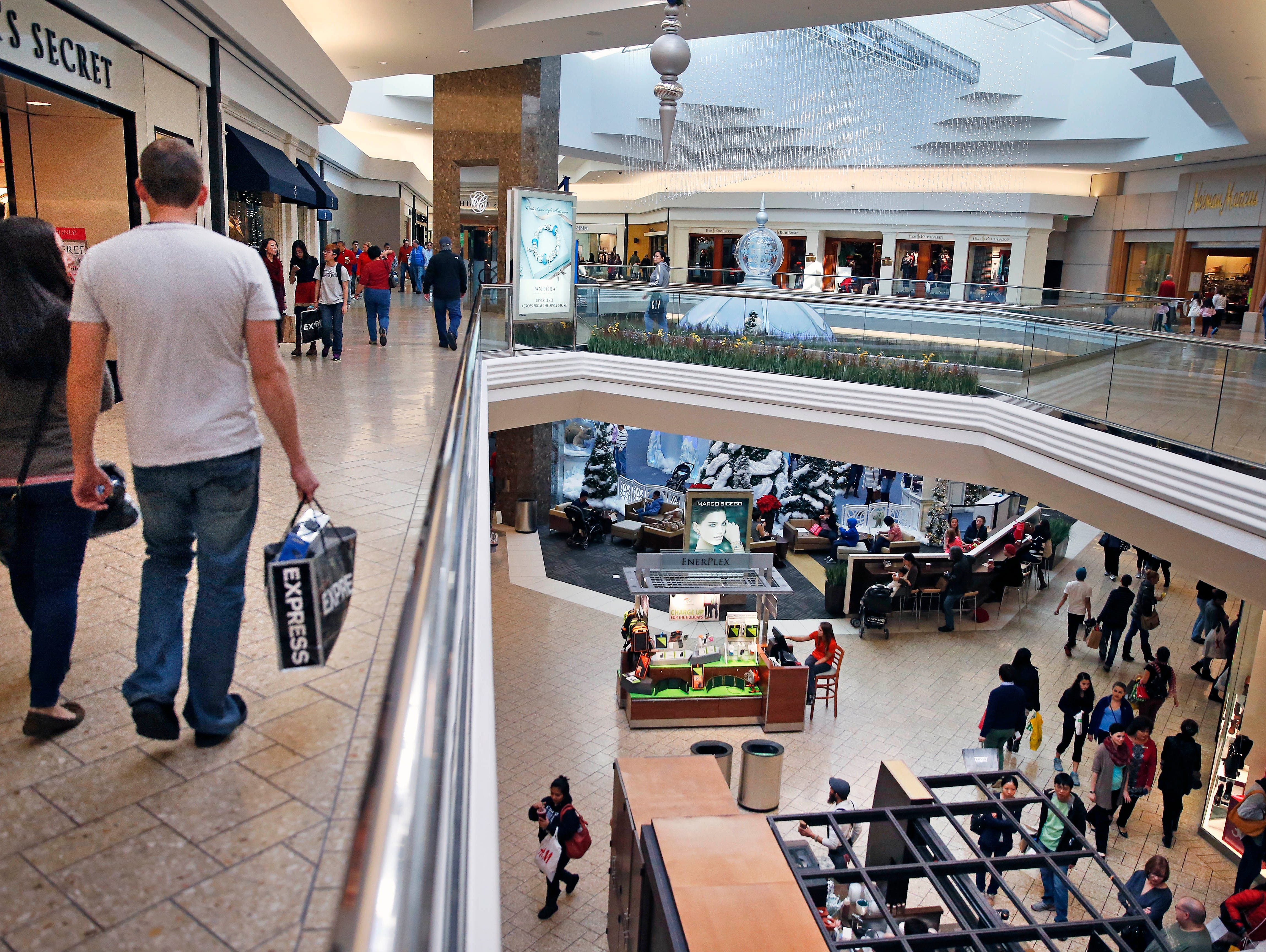 Shoppers troll foo sales at Cherry Creek Mall, in Denver on Black Friday 2013.