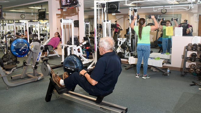 Scott Mahon, 87, works out in the Fitness Center on Nov. 16 at the Bloomfield Cultural Complex. The center was scheduled to be closed Thursday, but the Bloomfield City Council voted to keep it open.