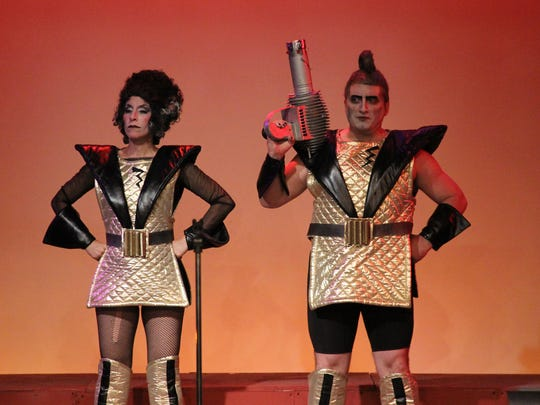 """Assisting Dr. Frank 'N' Furter is Penelope Alex as Magenta and Eric Parker as Riff-Raff in """"Rocky Horror Show."""""""