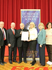 St. Francis Cathedral School was awarded a Joint Legislative Resolution on Dec. 15 from the New Jersey Senate and General Assembly to celebrate their 2017 National Blue Ribbon School award.  Pictured from left to right is Assemblyman Robert J. Karabinchak, Senator Patrick J.  Diegnan, Jr., Rev. Msgr. Robert J. Zamorski, Principal Barbara Stevens, Assemblywoman Nancy J. Pinkin and Vice Principal Judi Monteleone.