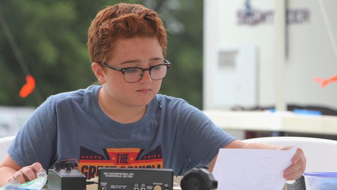 Christopher Schneider, 12, works with a Morse Code device.
