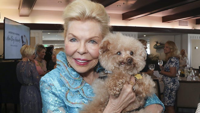 Lois Pope and 2018 Emerging Hero Dog Willow, a miniature poodle, at the American Humane Hero Dog Awards kick-off luncheon in February 2019.