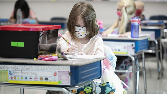 Second grader Ava Armstrong draws intently while wearing her face mask in class at the Louise A. Conley Elementary School in Whitman on the first day of school, Tuesday, Sept. 15, 2020.