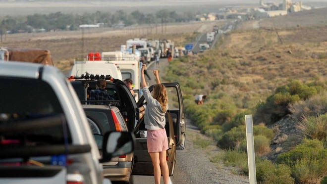 A women get off her car to stretch as Burning Man traffic gets backed up HWY 447 on August 26, 2013.