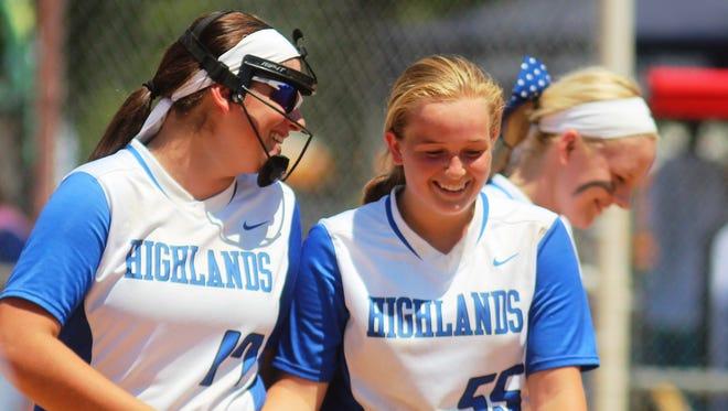 Highlands' Brennah Dutcher, left, and Rachel Gabbard share a moment before an inning.